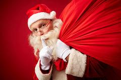 secret-santa-sack-xmas-gifts-asking-silence-61444457